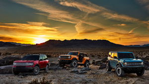 Ford Bronco and Bronco Sport in a desert